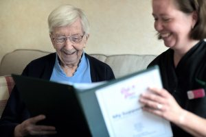 woman being shown her home caring journey