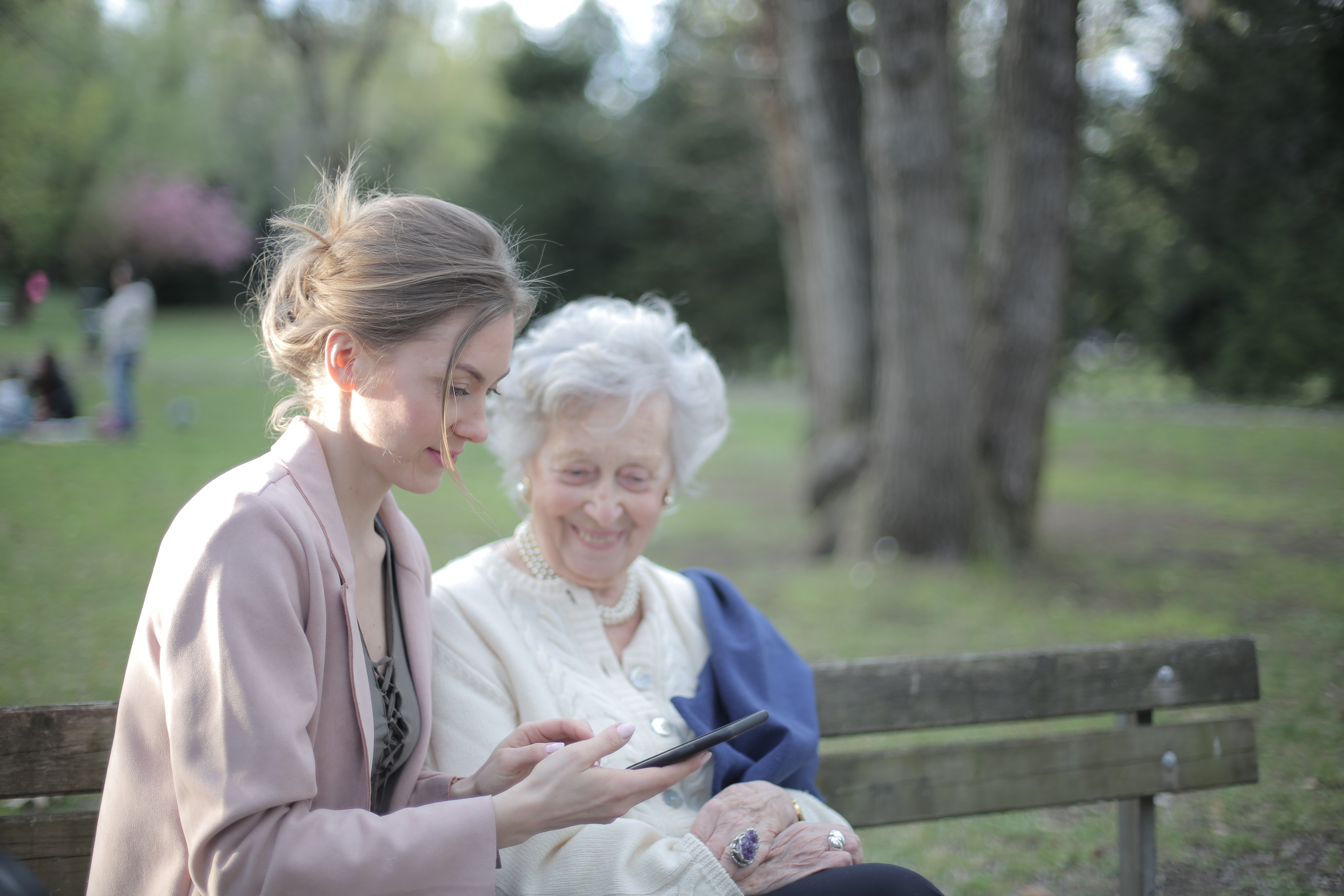 An elderly woman and a carer