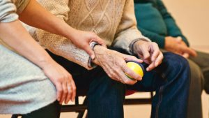 Someone living with dementia holding a stress ball