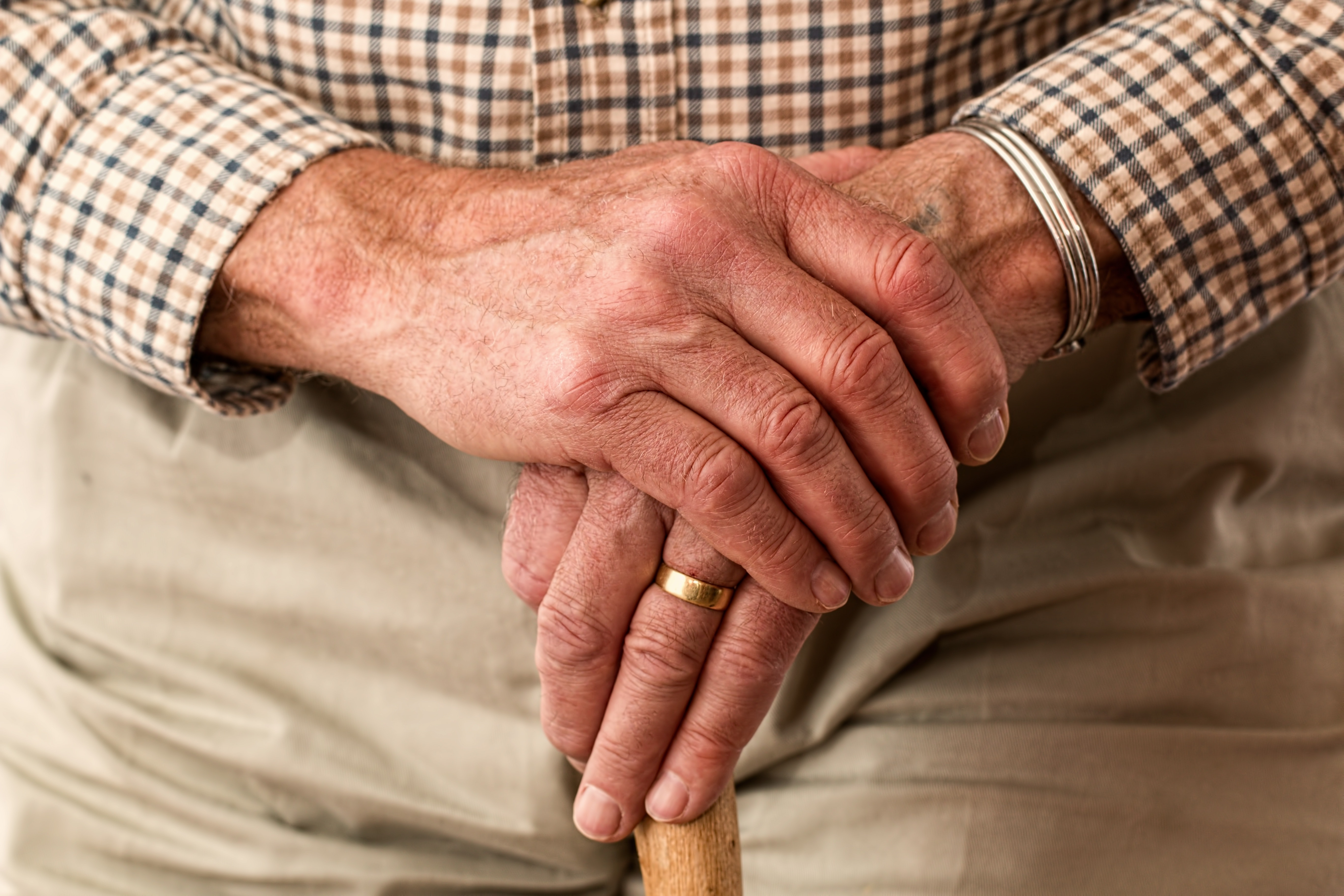 An elderly man with with a walking stick